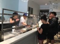 Staff making the ice cream rolls