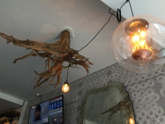 Some drift wood looking thing on the ceiling. Rustic-cabin vibes, man!